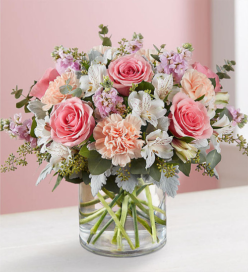 You'll have them at first blush when they see this stunning bouquet. We've gathered a lush mix of blooms in soft shades of pink, peach and white for everyday elegance. Artistically designed in a stylish clear glass cylinder vase, it's a heartfelt gift for birthdays, anniversaries or just to tickle someone pink.