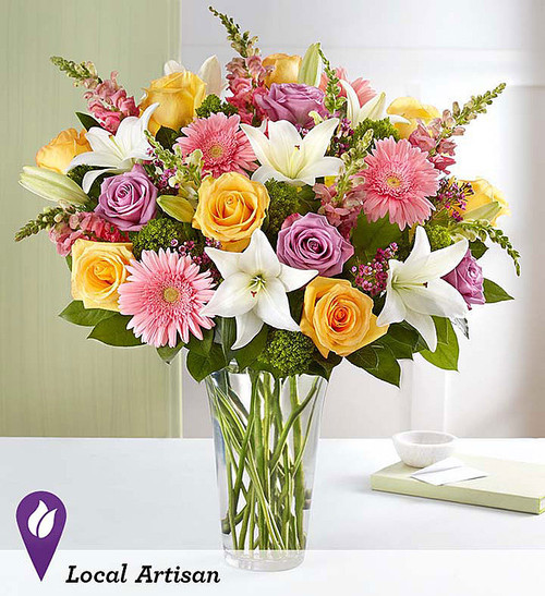 """DESIGN COUNCIL EXCLUSIVE Our deluxe arrangement delivers beauty in abundance. A cheerful mix of lavender, pink, yellow and white blooms was brought together by floral designer Develyn Reed of Stafford, Virginia, to boldly announce: """"Spring is here... and it's sensational!"""""""