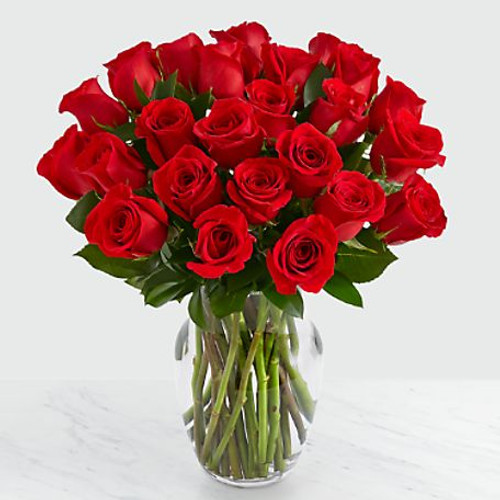 """Picked fresh from the farm to offer your special recipient a gift straight from the heart, our stunning Red Rose Bouquet is a classic romantic gesture that will have them falling head over heels. Hand gathered in select floral farms and flaunting a rich red hue, this stunning flower arrangement has been picked fresh for you to help you celebrate a birthday, anniversary, or convey your message of love and sweet affection. This bouquet includes the following: red roses and an assortment of lush greens BEST bouquet is approximately 20""""H x 16""""W."""