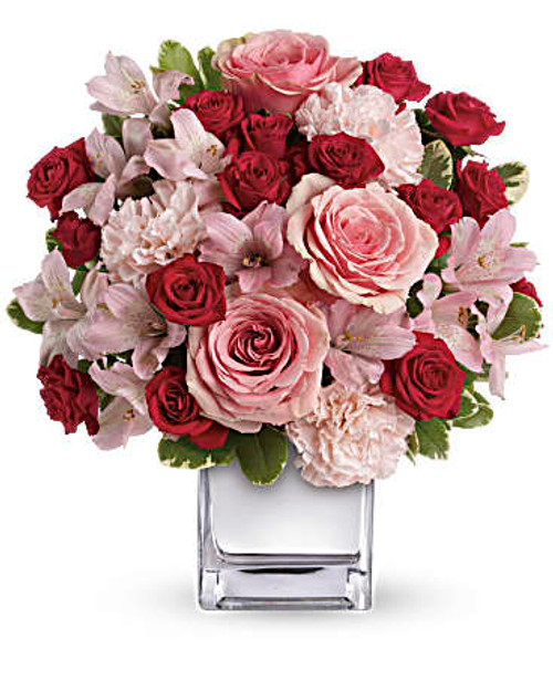 This impressive bouquet includes pink roses, red spray roses, pink alstroemeria and pink carnations accented with assorted greenery. Delivered in a mirrored silver cube. Orientation: All-Around