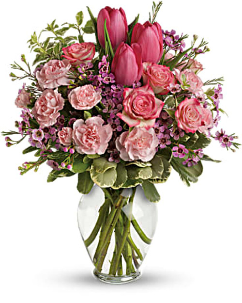 Includes pink roses, tulips, carnations and waxflower, accented with fresh pitta negra and variegated pittosporum. Delivered in a lovely glass vase. Orientation: All-Around