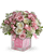 A light pink ribbon weaves through white and pink roses in a keepsake glass Baby Block vase. Orientation: All-Around