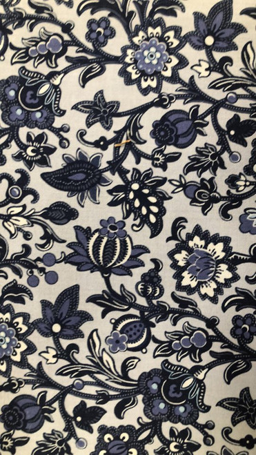 The background on this fabric is a medium blue.  The fabric itself is varying shades of blue.