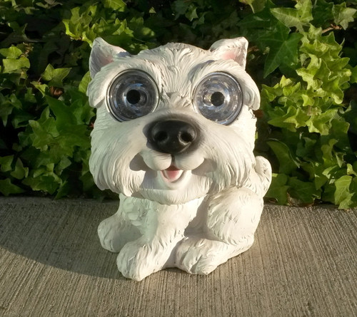 This solar dog statue is a very smart and full of self-esteem West Highland White Terrier