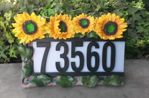 Solar powered address light with Sunflowers has 3 White LED.