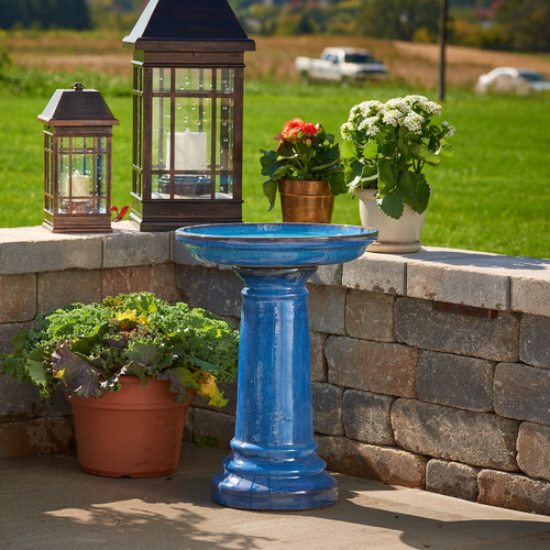 Smart Solar bird bath fountain is hand crafted using black clay, and finished with a long lasting blue glaze.