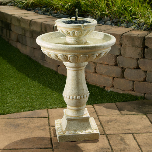 Solar fountain with battery backup has a 2 tier design and a creamy white Antique Stone Finish.