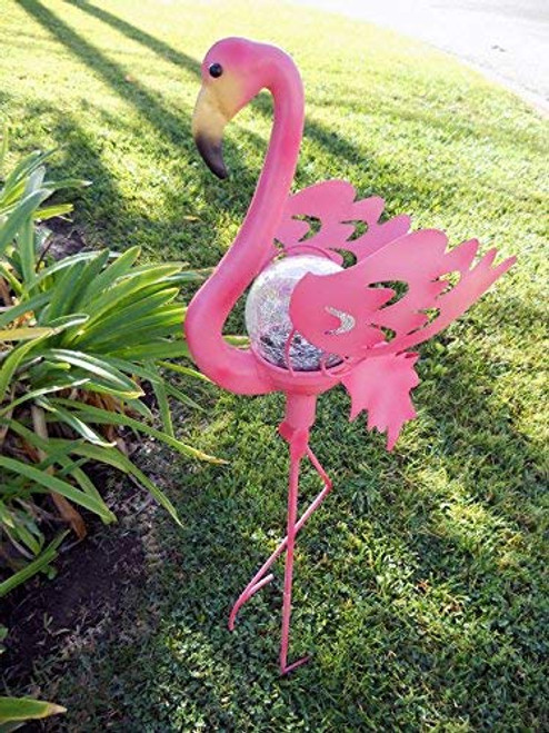 Pink Flamingo solar stake light is made from metal, and stands 3 feet high installed in the ground.