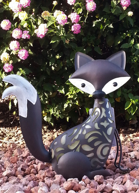 "Fox solar statue is a large animal shaped solar light sized at 15"" H x 15"" L x 5"" W."