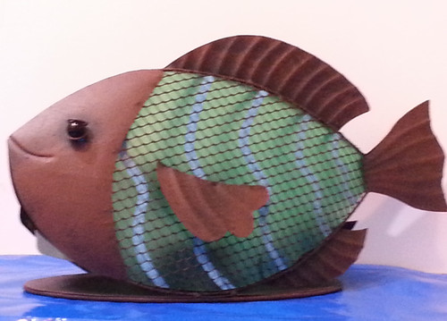 Fish statue with solar light sits on a flat oval base for easy arrangement in your coastal themed garden.