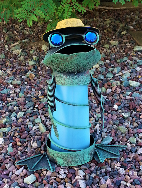 Frog solar statue stands 14 inches high, and is made from hand painted metal and PVC film.