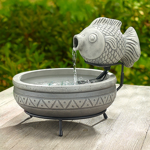 The Fish solar garden fountain, by Smart Solar, is made from light gray concrete and weighs 16.50 pounds without water.