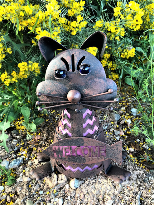 Cat solar statue is almost 12 inches high, and made from rustic brown metal and PVC film.