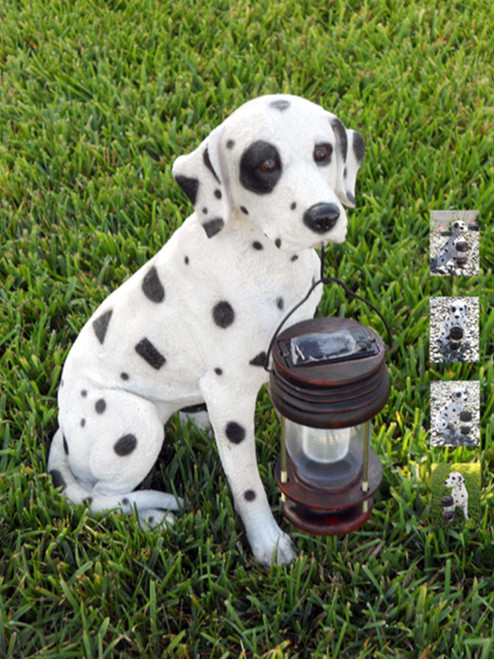 Animal shaped solar light is a Dalmatian Dog holding a hanging solar lantern.