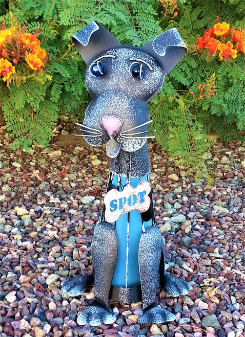 Dog solar light is named Spot. He is handcrafted from Metal and is 18 inches tall.