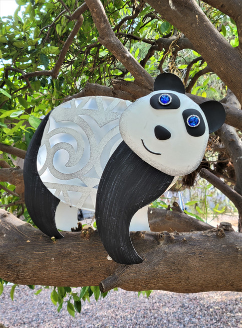 Panda solar light statue is made from metal and PVC film that allows sunshine to charge the internal battery.