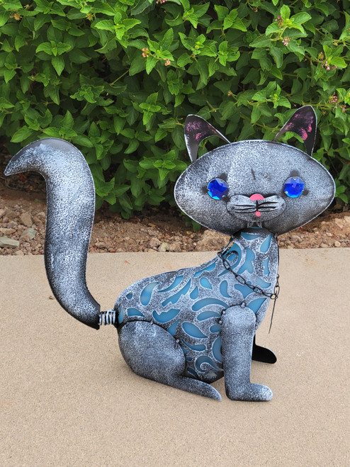 Animal shaped solar light is a cat statue made from metal, with PVC film that forms her cat body, and is 16 inches long x 4.75 inches wide x 15 inches high.