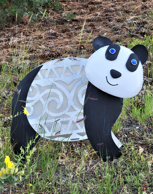 Solar Panda light is 18 L x 7 W x 17 Inches High, with a Jungle Hut Swirl Design for her White body.