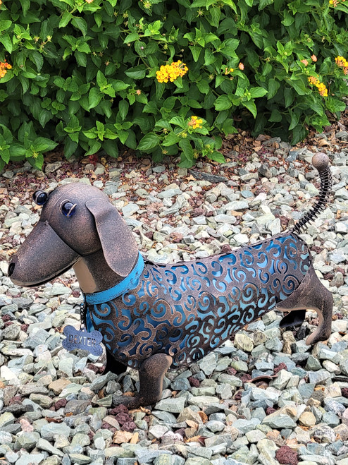 Solar animal garden light is a Dachshund shaped dog with Blue PVC Film and a Blue LED to light up Midnight Blue at night.