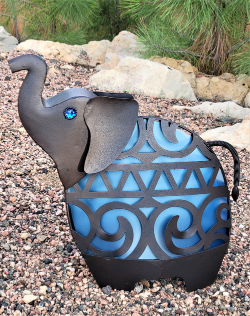 Animal shaped solar light is a baby elephant that stands 16 inches high and weighs 3 pounds.