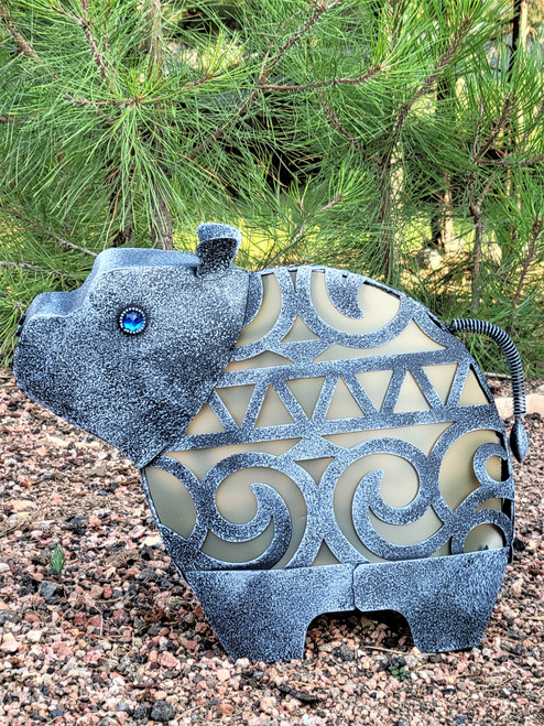Baby hippo is a solar animal garden light with a Jungle Hut design for his metal body.