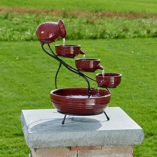 Solar Cascading Bowls Water Fountain  has a Red Lava finish and is made from Ceramic.