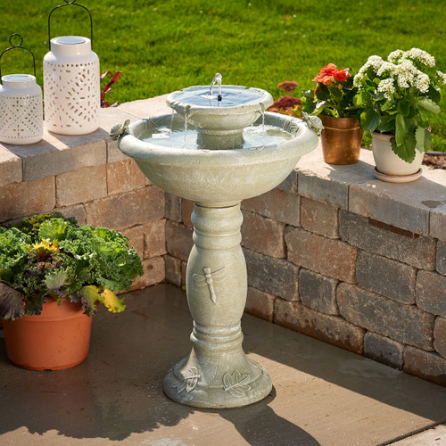 Solar tiered water fountain, with a Weathered Stone finish, has Turtles and Dragonflies to enjoy as the water comes out of the top spout.