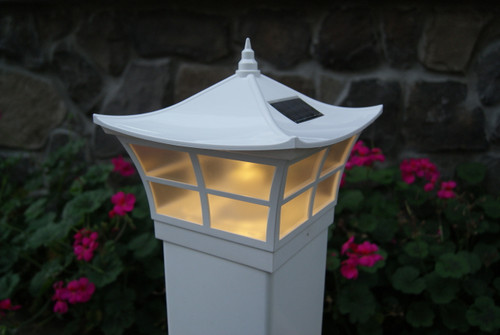 The 4x4 and 5x5 White Ambience are solar deck post caps for vinyl fence posts.