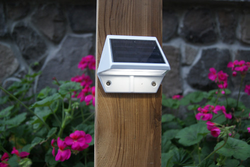 Solar deck rail lights shine the light down to the steps and flooring for your safety.