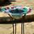 Solar bird bath is made from glass and steel, with a one year warranty.