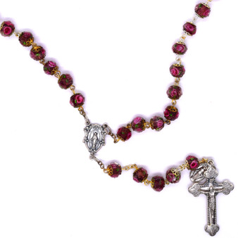 Rosary of Eight Millimeter Millefiori Style Glass Beads Capped in Silver Tone.
