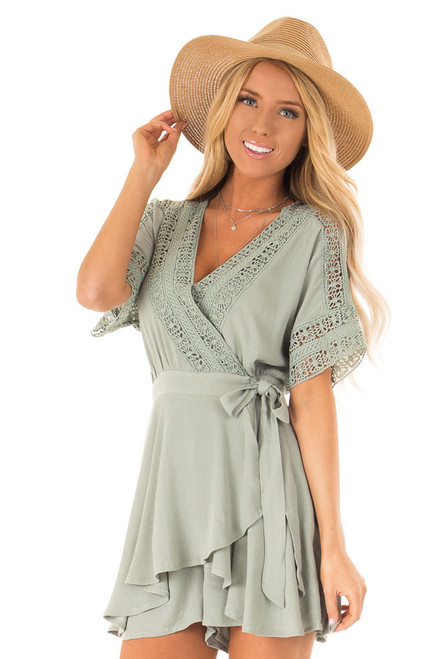 5820cffb380 Navy Wrap Style Romper with Crochet Detail - Lime Lush Boutique