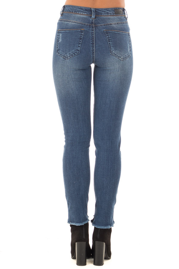 Dark Wash Denim Skinny Distressed Jeans with Uneven Hem back view
