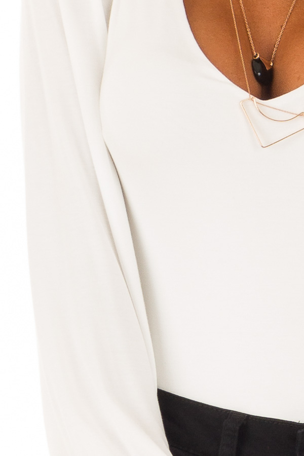 White Long Sleeve Bodysuit with Plunging Neckline detail