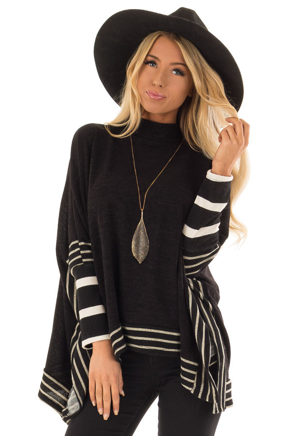 Black Long Sleeve Poncho with Off White Striped Trim front close up