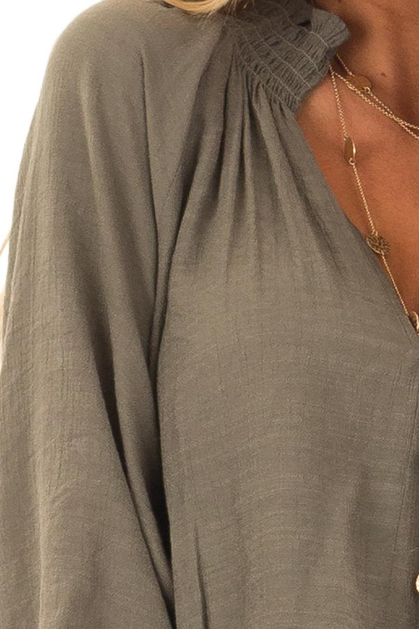 Olive V Neck Blouse with Bishop Sleeves and Smocked Detail detail