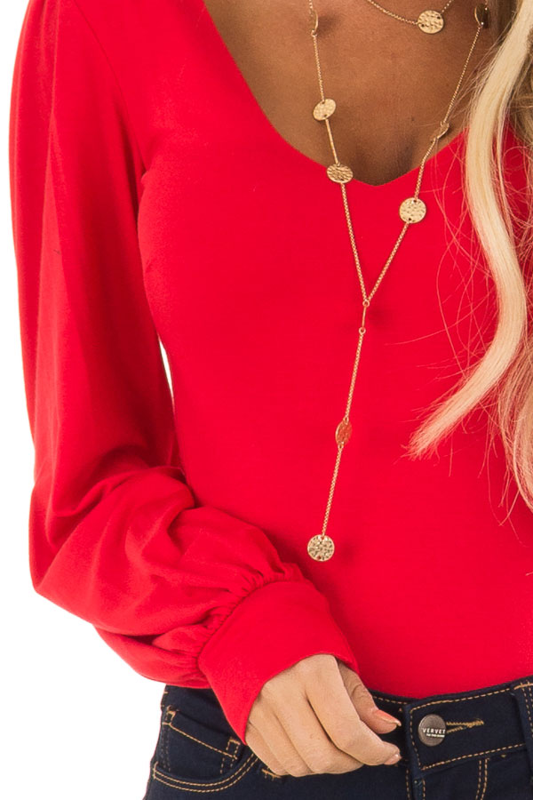 Ruby Red Long Sleeve Bodysuit with Plunging Neckline detail
