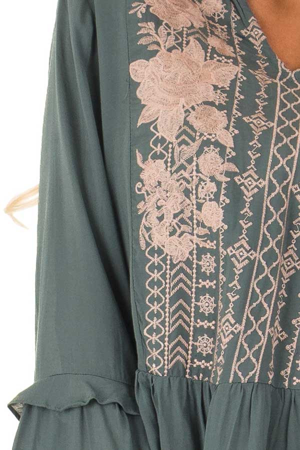 Dusty Teal Embroidered Peplum Top with Long Bell Sleeves detail