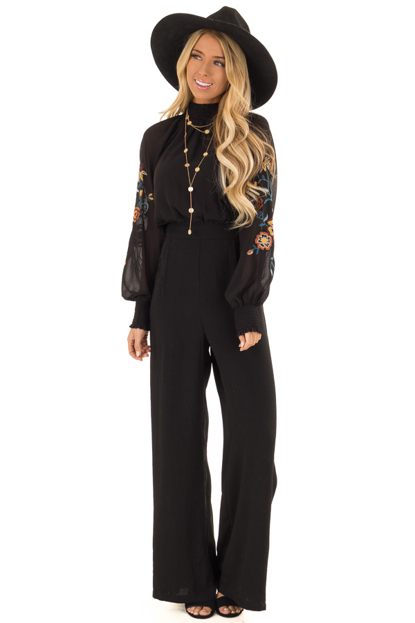 f8f693521f0a Black Jumpsuit with Smocked High Neck and Floral Embroidery front full body