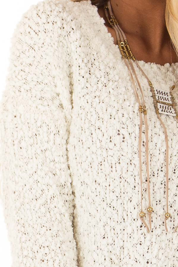 Ivory Long Sleeve Pullover Sweater with Side Slits detail
