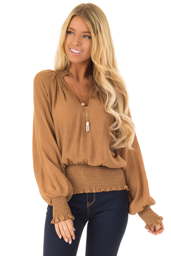 Caramel V Neck Blouse with Bishop Sleeves and Smocked Detail front close up