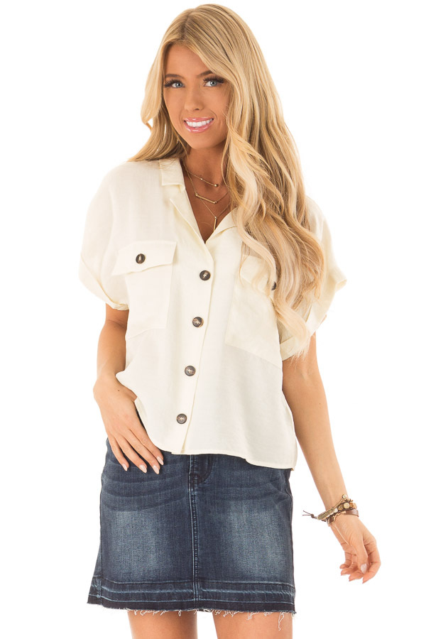 Cream Button Up Short Sleeve Blouse with Pocket Details front close up