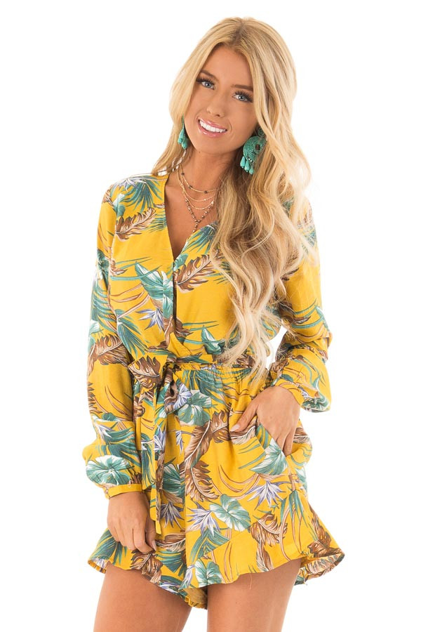 577217a34bda Mustard Multi Tropical Palm Long Sleeve Front Wrap Romper front close up