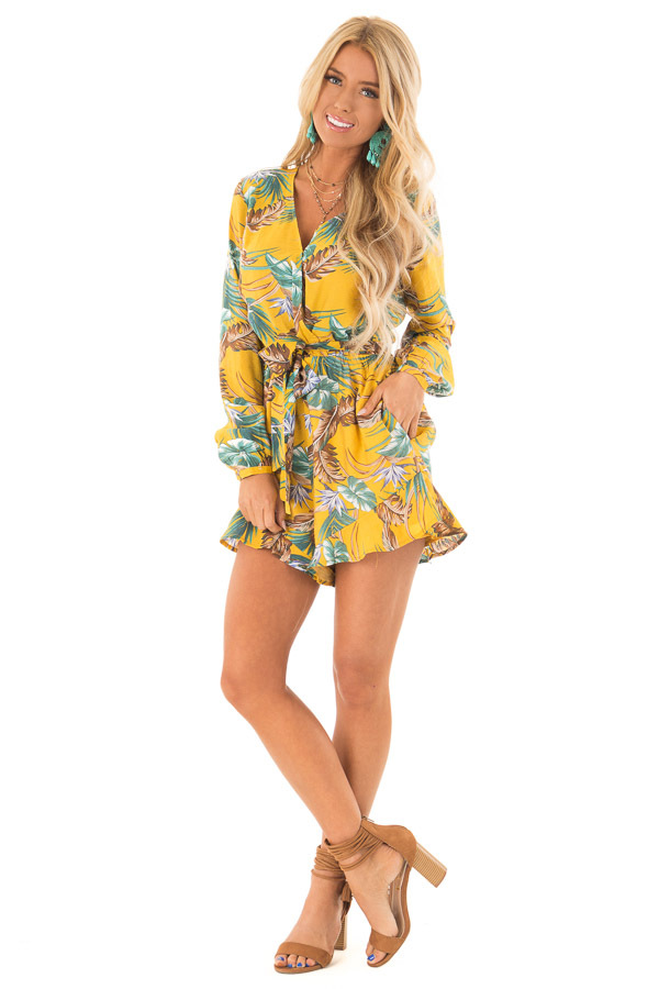 19d58d091e0 Mustard Multi Tropical Palm Long Sleeve Front Wrap Romper front full body  ...