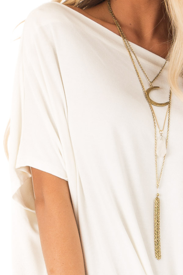Ivory Short Sleeve Off the Shoulder Top with Twisted Front detail