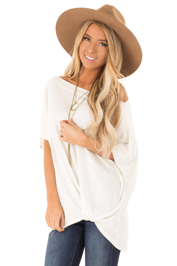 Ivory Short Sleeve Off the Shoulder Top with Twisted Front font close up