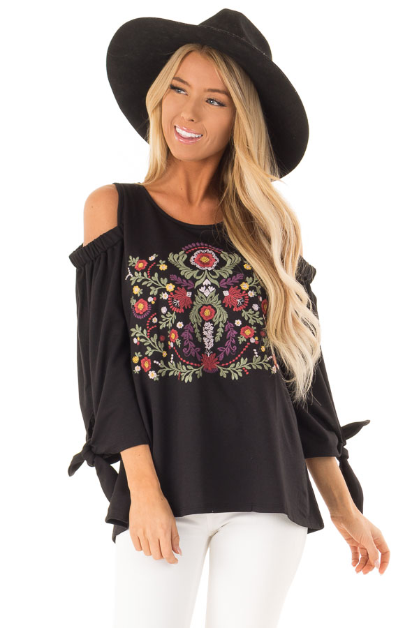 588f82d5cb1181 Raven Black Cold Shoulder Top with Embroidered Floral Detail front close up