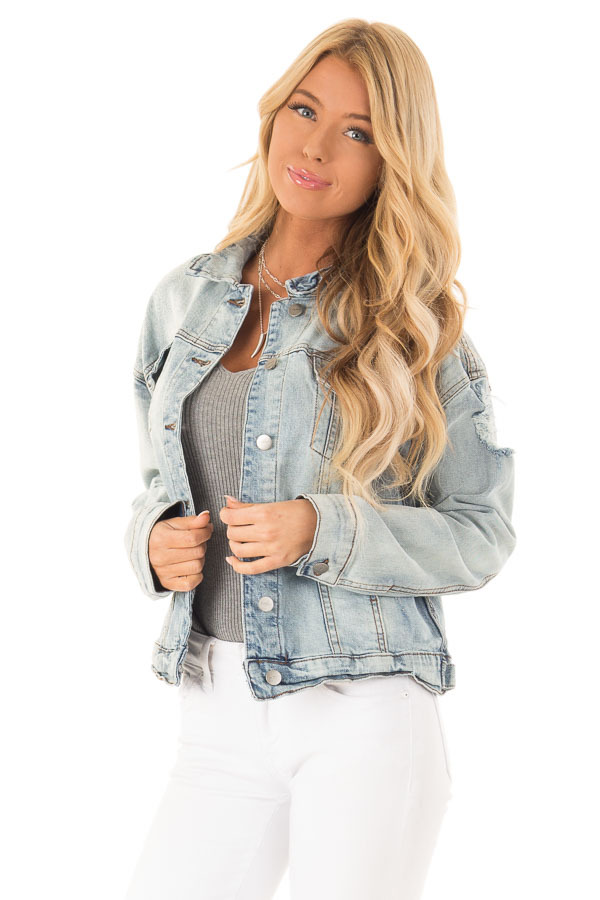 Light Wash Distressed Button Up Denim Jacket front close up