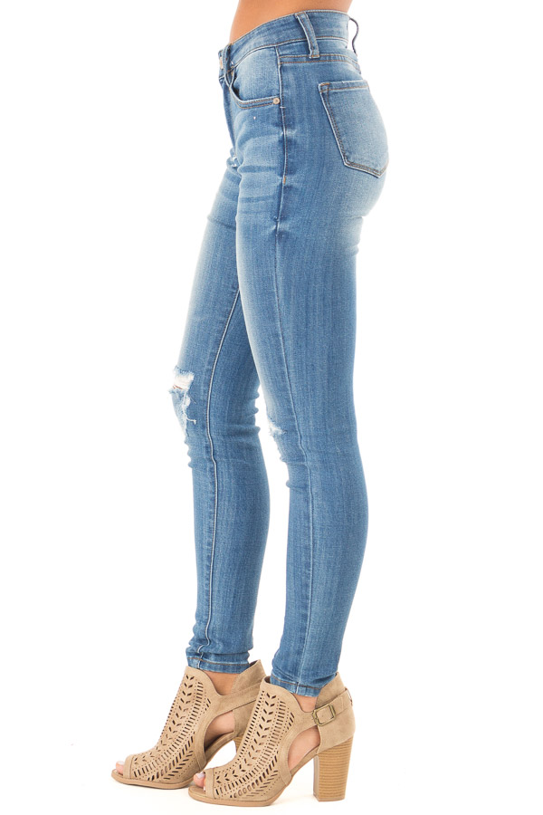Medium Wash Mid Rise Skinny Jeans with Distressed Details side view