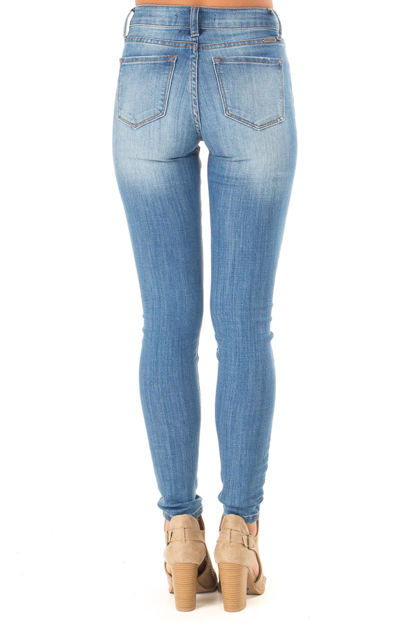 Medium Wash Mid Rise Skinny Jeans with Distressed Details back view